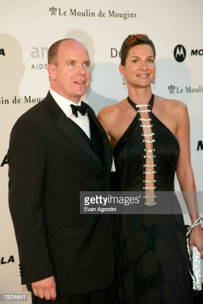 Prince Albert of Monacco with date arriving at amfAr's Cinema against AIDS 2002 benefit gala at Le Moulin de Mougins during the 55th Cannes Film...