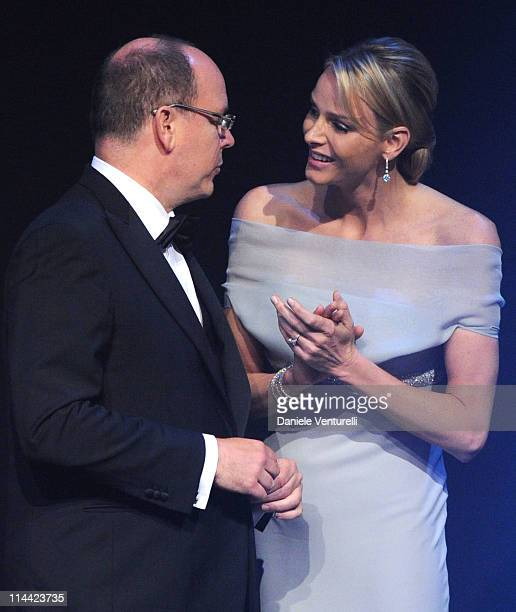Prince Albert of Monaco and Charlene Wittstock appear onstage at amfAR's Cinema Against AIDS Gala during the 64th Annual Cannes Film Festival at...