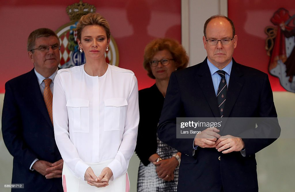 Prince Albert of Monaco and Princess <a gi-track='captionPersonalityLinkClicked' href=/galleries/search?phrase=Charlene+-+Princess+of+Monaco&family=editorial&specificpeople=726115 ng-click='$event.stopPropagation()'>Charlene</a> of Monaco on the podium during the Monaco Formula One Grand Prix at Circuit de Monaco on May 29, 2016 in Monte-Carlo, Monaco.