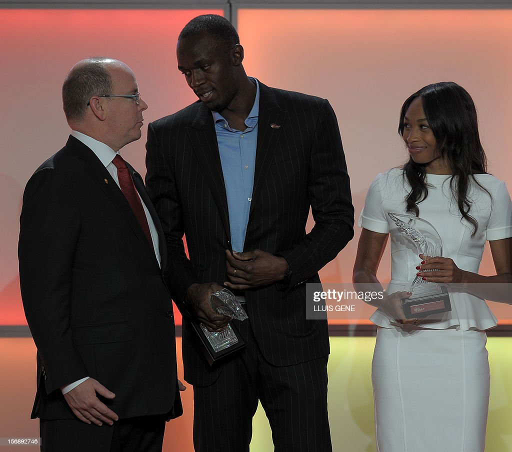 Prince Albert of Monaco chats with Jamaican athlete Usain Bolt and US sprinter Allyson Felix as they pose for photographers during the IAAF (International Association of Athletics Federations)´s Athlete of the Year Award marking its centenary on November 24, 2012 in Barcelona.