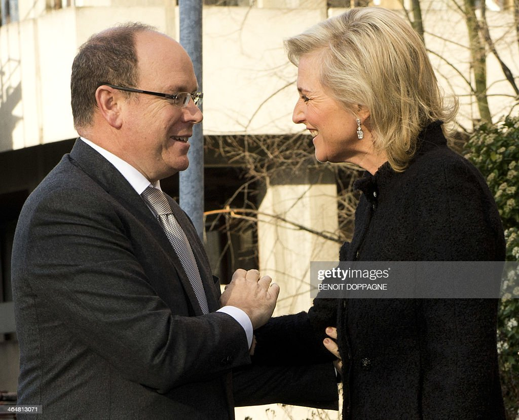 Prince Albert of Monaco (L) is welcomed by Princess Astrid of Belgium who cedes the Honorary Presidency of the EORTC Charitable Trust, European Organisation for Research and Treatment of Cancer, to Prince Albert of Monaco, in Brussels, on January 2014.