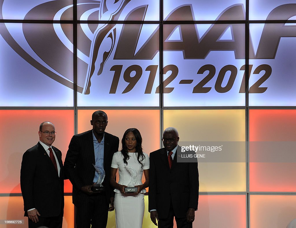 Prince Albert of Monaco, Jamaican athlete Usain Bolt, US sprinter Allyson Felix and IAAF (International Association of Athletics Federations) President Lamine Diack pose for photographers during the IAAF´s Athlete of the Year Award marking its centenary on November 24, 2012 in Barcelona. AFP PHOTO/ LLUIS GENE