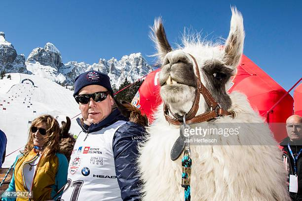 Prince Albert of Monaco poses beside a Lama for a picture during the Star Team for Children Charity Event on March 28 2015 in Sexten Italy