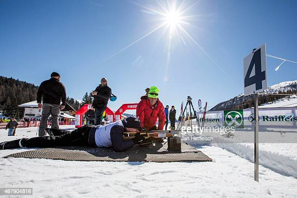 Prince Albert of Monaco takes position to shoot during the biathlon challenge of Star Team for Children Charity Event on March 28 2015 in Sexten Italy