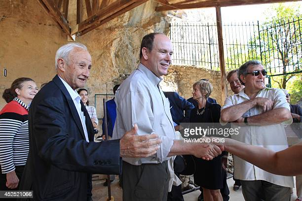 Prince Albert of Monaco with French archeologist geologist and prehistorian Henri Delumley enters the Caune de L'Arago for the 50th anniversary of...
