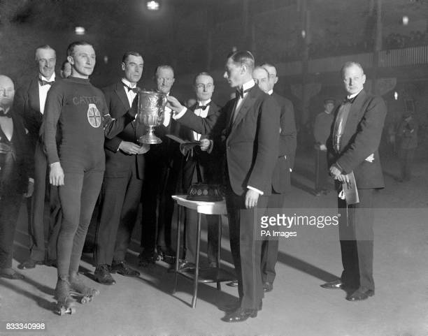Prince Albert The Duke of York presents the trophy to TJ Wilson the winner of the One Mile Amateur Roller Speed Championship of Great Britain held at...