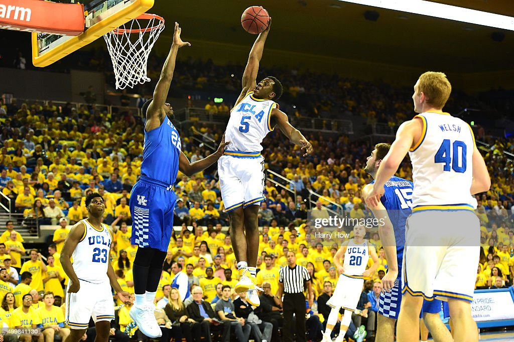 Prince Ali #5 of the UCLA Bruins dunks over Alex Poythress #22 of the Kentucky Wildcats during an 87-77 UCLA win at Pauley Pavilion on December 3, 2015 in Los Angeles, California.