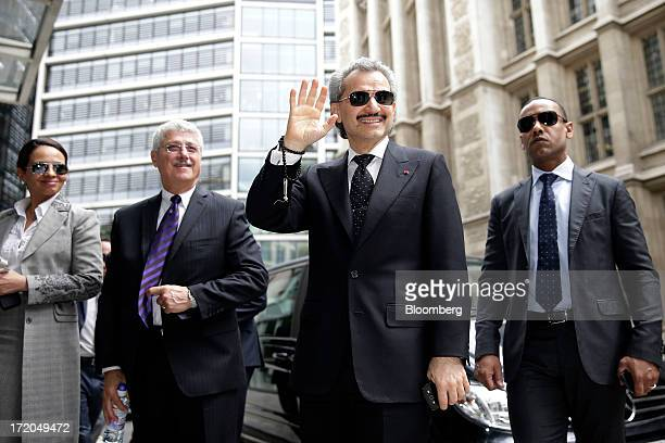 Prince Alwaleed Bin Talal Saudi billionaire and founder of Kingdom Holding Co center waves as he returns to the High Court after a lunch break in...