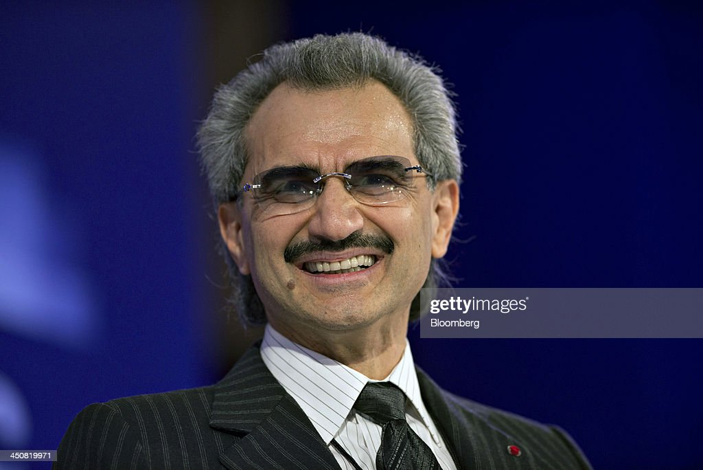 <a gi-track='captionPersonalityLinkClicked' href=/galleries/search?phrase=Prince+Alwaleed+Bin+Talal&family=editorial&specificpeople=681642 ng-click='$event.stopPropagation()'>Prince Alwaleed Bin Talal</a>, Saudi billionaire and founder of Kingdom Holding Co., smiles while speaking at the Bloomberg Year Ahead: 2014 conference in Chicago, Illinois, U.S., on Wednesday, Nov. 20, 2013. Alwaleed said President Barack Obama lacks a 'comprehensive and coherent foreign policy' toward the Arab world. Photographer: Daniel Acker/Bloomberg via Getty Images