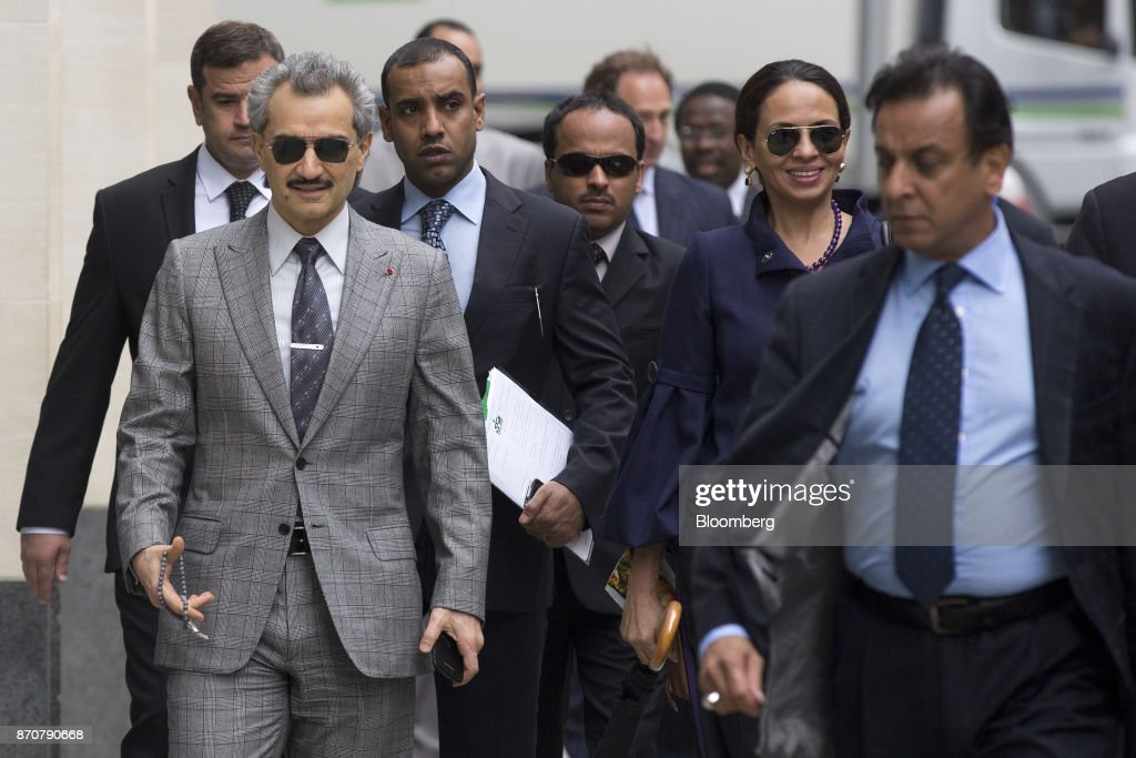 Prince Alwaleed Bin Talal, Saudi billionaire and founder of Kingdom Holding Co., left, arrives to give evidence at the High Court in London, U.K., on Tuesday, July 2, 2013. Saudi Arabias King Salman embarked on the most sweeping crackdown yet of his reign, ordering security forces to arrest senior princes including one of the worlds richest men and driving out one of the most prominent officials from his ministerial role. Those detained included billionaire Prince Alwaleed bin Talal, who was picked up at his desert camp outside Riyadh, according to a senior Saudi official. Our editors select the best archive images of Prince Alwaleed bin Talal. Photographer: Simon Dawson/Bloomberg via Getty Images