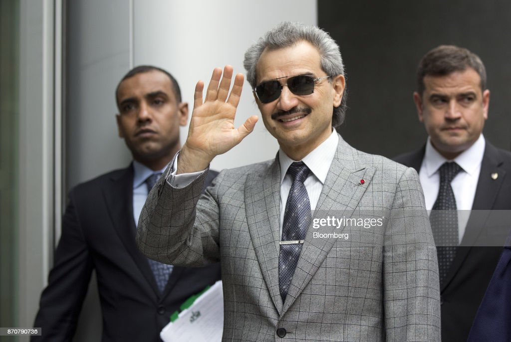 Prince Alwaleed Bin Talal, Saudi billionaire and founder of Kingdom Holding Co., center, waves as he arrives to give evidence at the High Court in London, U.K., on Tuesday, July 2, 2013. Saudi Arabias King Salman embarked on the most sweeping crackdown yet of his reign, ordering security forces to arrest senior princes including one of the worlds richest men and driving out one of the most prominent officials from his ministerial role. Those detained included billionaire Prince Alwaleed bin Talal, who was picked up at his desert camp outside Riyadh, according to a senior Saudi official. Our editors select the best archive images of Prince Alwaleed bin Talal. Photographer: Simon Dawson/Bloomberg via Getty Images