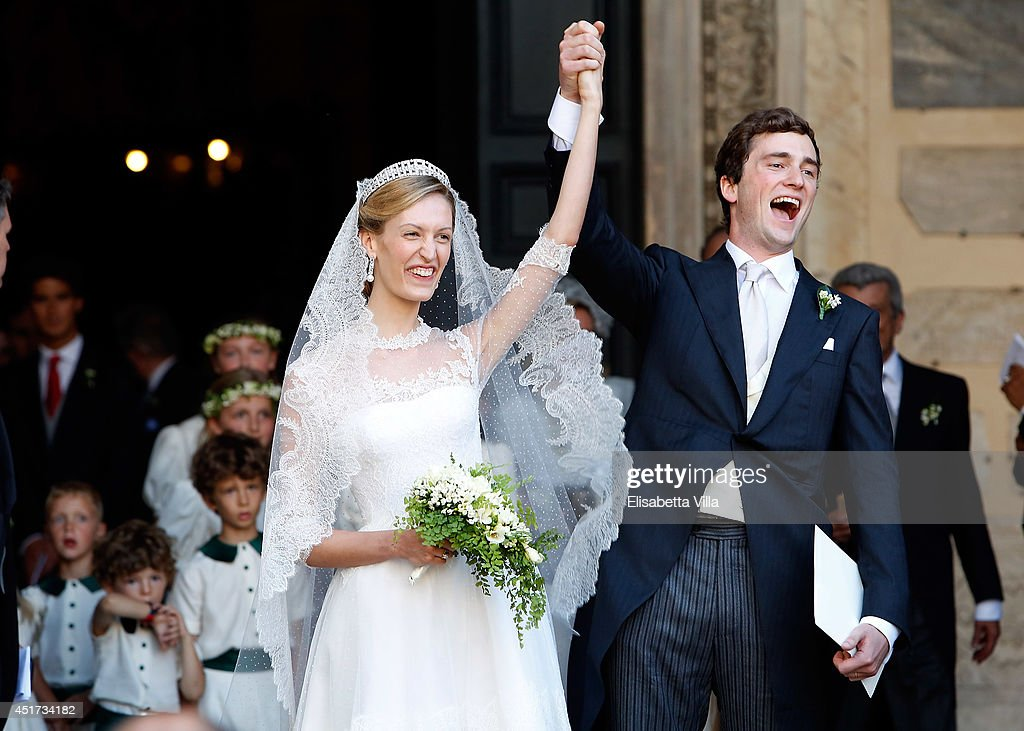 <a gi-track='captionPersonalityLinkClicked' href=/galleries/search?phrase=Prince+Amedeo+of+Belgium&family=editorial&specificpeople=221543 ng-click='$event.stopPropagation()'>Prince Amedeo of Belgium</a> and Princess Elisabetta Maria celebrate after their wedding ceremony at Basilica Santa Maria in Trastevere on July 5, 2014 in Rome, Italy.