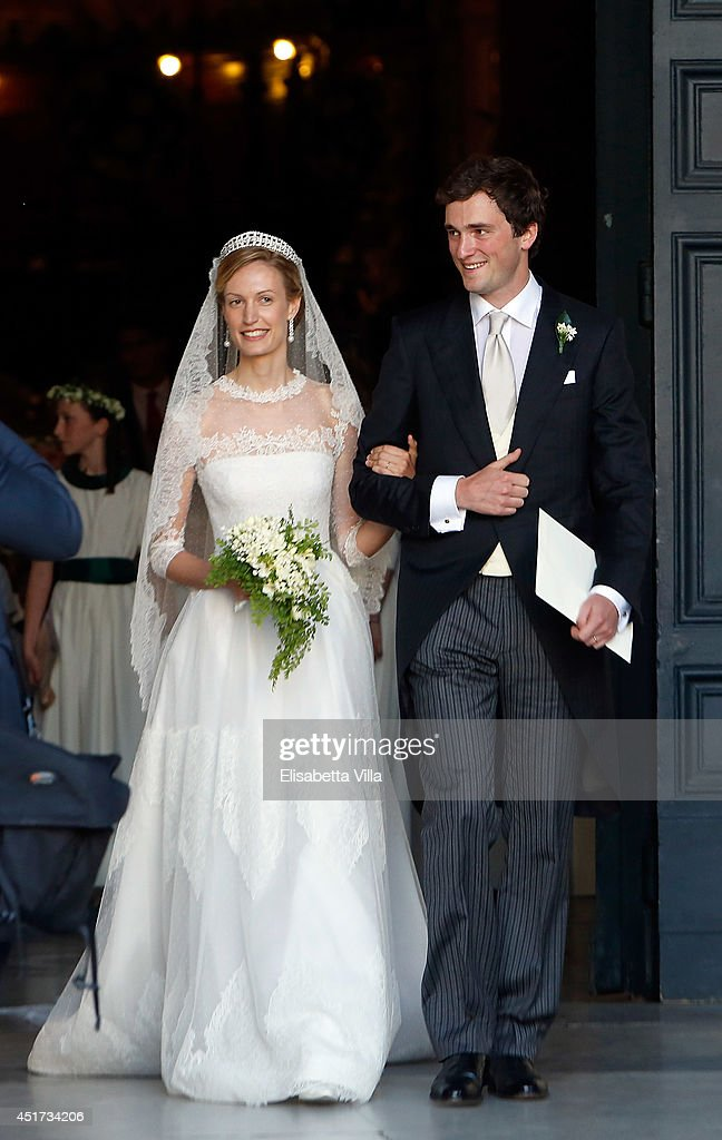 Prince Amedeo of Belgium and Princess Elisabetta Maria celebrate after their wedding ceremony at Basilica Santa Maria in Trastevere on July 5, 2014 in Rome, Italy.