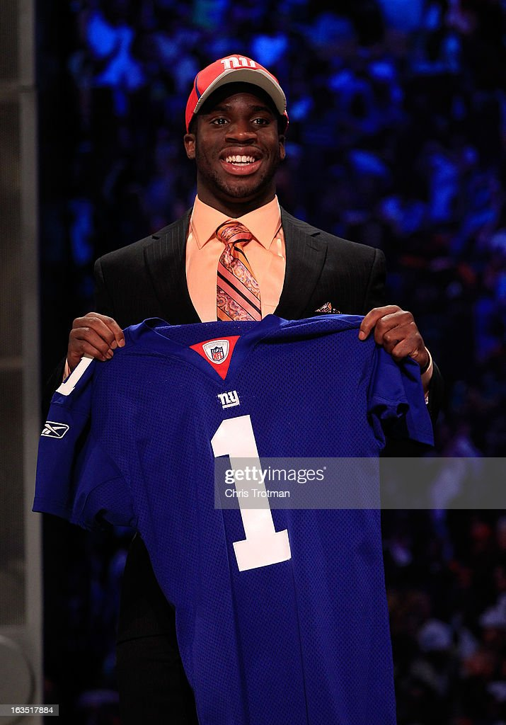 <a gi-track='captionPersonalityLinkClicked' href=/galleries/search?phrase=Prince+Amukamara&family=editorial&specificpeople=6357867 ng-click='$event.stopPropagation()'>Prince Amukamara</a>, #19 overall pick by the New York Giants, holds up a jersey on stage during the 2011 NFL Draft at Radio City Music Hall on April 28, 2011 in New York City.