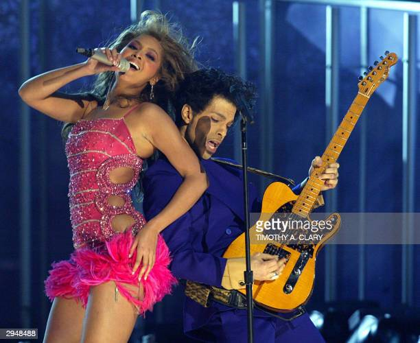 Prince and Beyonce perform the opening act of the 46th Annual Grammy Awards at the Staples Center in Los Angeles 08 February 2004 AFP PHOTO/Timothy A...