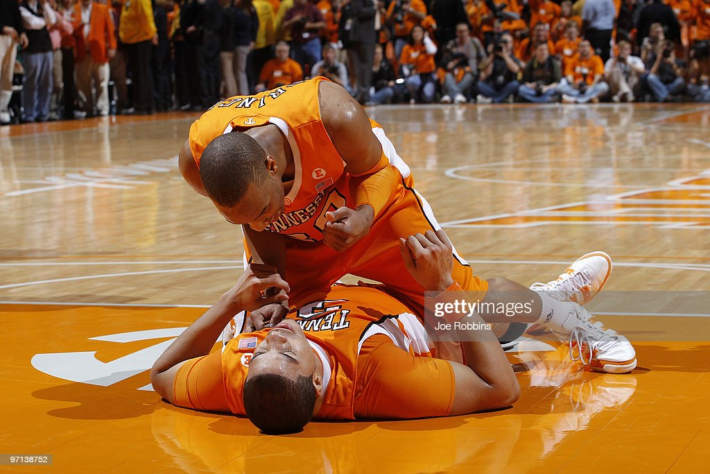 P Prince and Brian Williams of the Tennessee Volunteers celebrate after Williams drew a foul late in the game against the Kentucky Wildcats at...