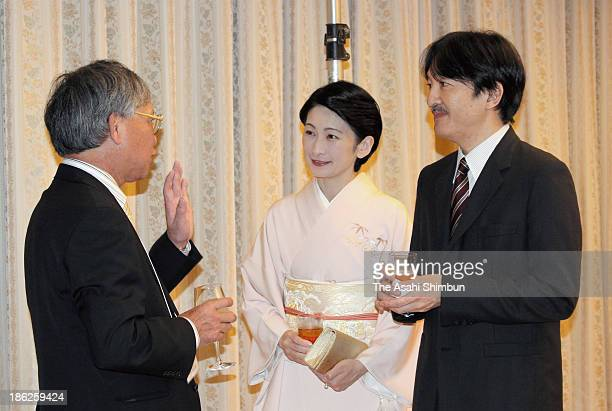 Prince and Princess Akishino talk with the representetive of Japanese Prefectural Associations in Brazil Akinori Sonoda during the reception for the...