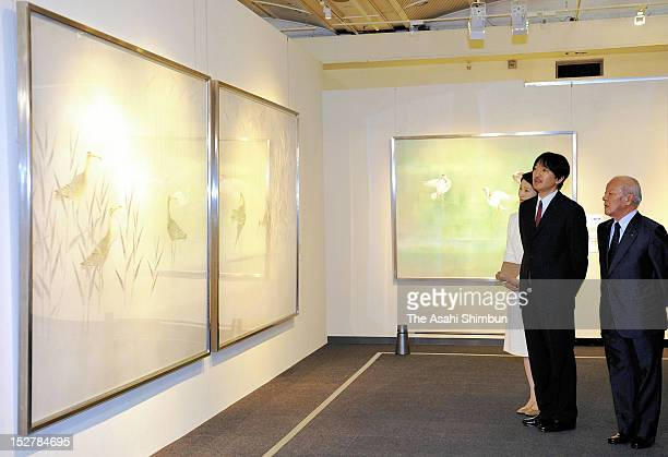 Prince and Princess Akishino watch traditional Japanese paintings by Atsushi Uemura nihonga artist on September 25 2012 in Tokyo Japan