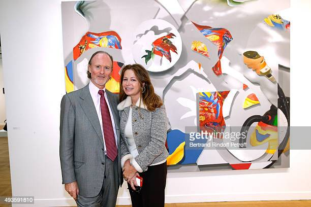 Prince and Princess Pierre d'Arenberg pose in front of a piece by artist Pieter Schoolwerth during the 'FIAC 2015 International Contemporary Art...