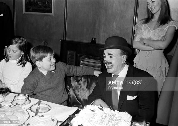 Prince Andrew and Charlie Caroli the World's Greatest Clown share a joke over a birhtday tea party at the Empire Pool Wembley on Charlie's 58th...