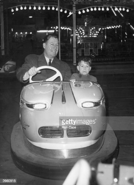 Prince Andrew and his detective in a dodgem car at the Olympia fun fair
