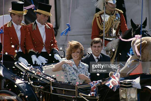 Prince Andrew and Sarah Ferguson leave Buckingham Palace for their honeymoon after their wedding London 23rd July 1986