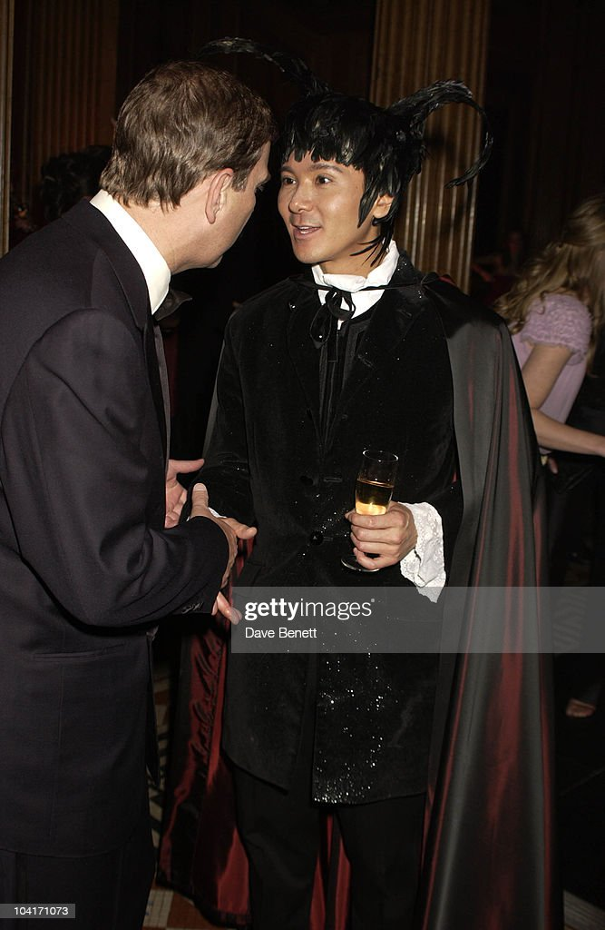 Prince Andrew & Andy Wong, Hong Kong Fanancier Andy Wong And His Wife Pattie Throw Their Annual Chinese New Year Party. In Fancy Dress The Dress Code Was Mystery Vamp And Seduction And Most Of Londons Society Turned Up To A Mysterious Event In The Same Theme As 'Eyes Wide Shut' With Masked Young Women With Very Little On, As Prince Andrew Found Out.!