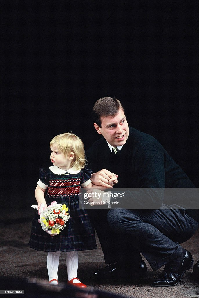 Prince Andrew, Duke of York, and his daughter Beatrice visit Sarah, Duchess of York, and the newborn Princess Eugenie at The Portland Hospital on March 25, 1990 in London, England.