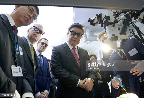Prince Andrew Duke of York Chancellor George Osborne and Chinese President Xi Jinping wear 3D glasses to view robotic equipment with Phd student...