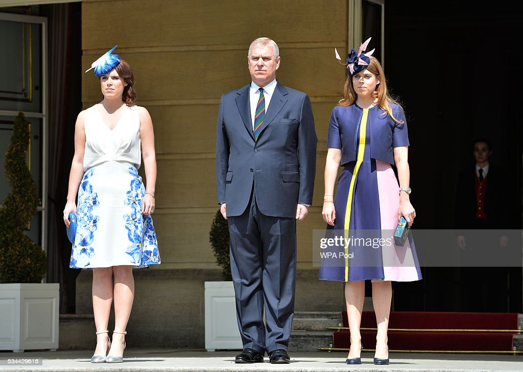 Prince Andrew, Duke of York hosts the annual Not Forgotten Association Garden Party, accompanied by Princess Beatrice and Princess Eugenie (L) at Buckingham Palace on May 26, 2016 in London, England.