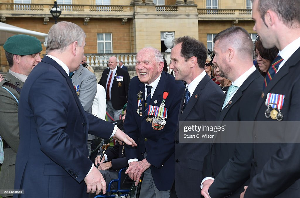 Prince Andrew, Duke of York meets guests as he attends a Buckingham Palace garden party for 'The Not Forgotten Association' at Buckingham Palace on May 26, 2016 in London, England.