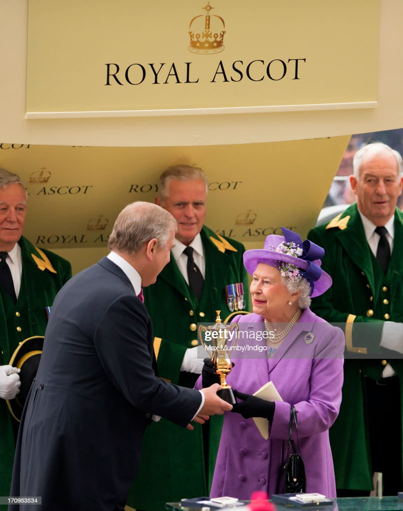 Prince Andrew, Duke of York presents his mother Queen <a gi-track='captionPersonalityLinkClicked' href=/galleries/search?phrase=Elizabeth+II&family=editorial&specificpeople=67226 ng-click='$event.stopPropagation()'>Elizabeth II</a> with the Gold Cup after her horse Estimate won the feature race on Ladies Day of Royal Ascot at Ascot Racecourse on June 20, 2013 in Ascot, England.