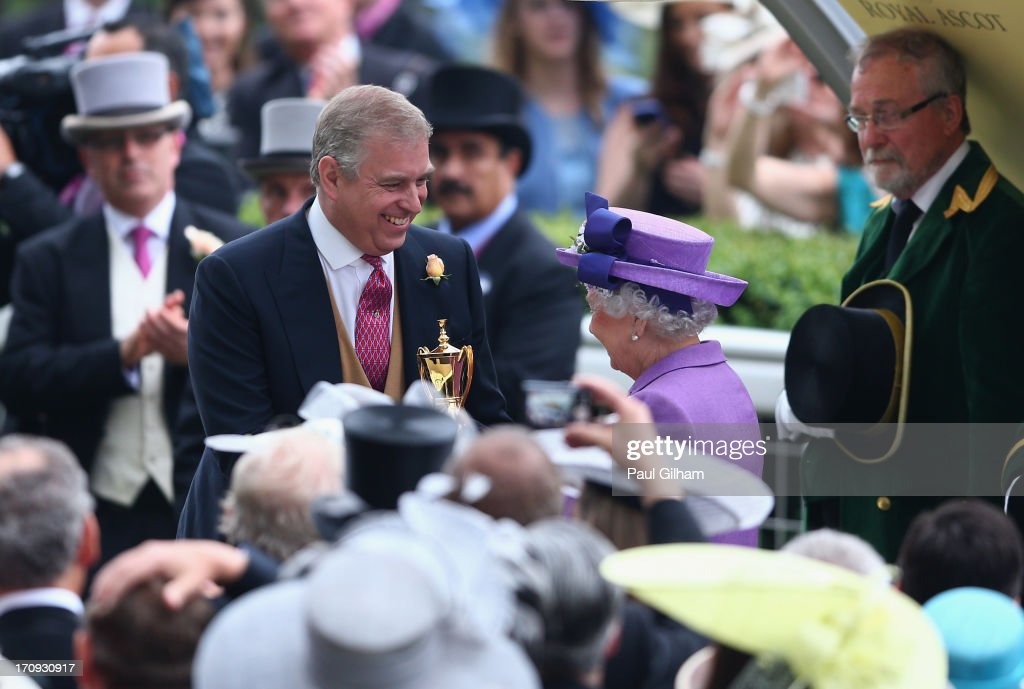 <a gi-track='captionPersonalityLinkClicked' href=/galleries/search?phrase=Prince+Andrew+-+Duke+of+York&family=editorial&specificpeople=160175 ng-click='$event.stopPropagation()'>Prince Andrew</a>, Duke of York presents Queen <a gi-track='captionPersonalityLinkClicked' href=/galleries/search?phrase=Elizabeth+II&family=editorial&specificpeople=67226 ng-click='$event.stopPropagation()'>Elizabeth II</a> with The Gold Cup trophy after the Queen's horse Estimate ridden by Ryan Moore won The Gold Cup on Ladies' Day during day three of Royal Ascot at Ascot Racecourse on June 20, 2013 in Ascot, England.