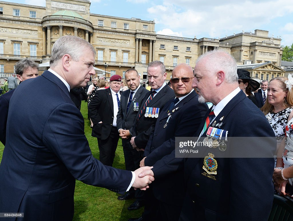 Prince Andrew, Duke of York talks to guests as he hosts the annual Not Forgotten Association Garden Party at Buckingham Palace on May 26, 2016 in London, England.