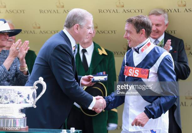 Prince Andrew Duke of York with jockey Richard Hughes after he won The Coronation Stakes with Sky Lantern on day four of Royal Ascot at Ascot...