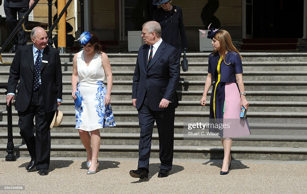 Prince Andrew, The Duke of York with his daughters Princess Beatrice and Princess Eugenie as they attend a Buckingham Palace garden party for 'The Not Forgotten Association' at Buckingham Palace on May 26, 2016 in London, England.