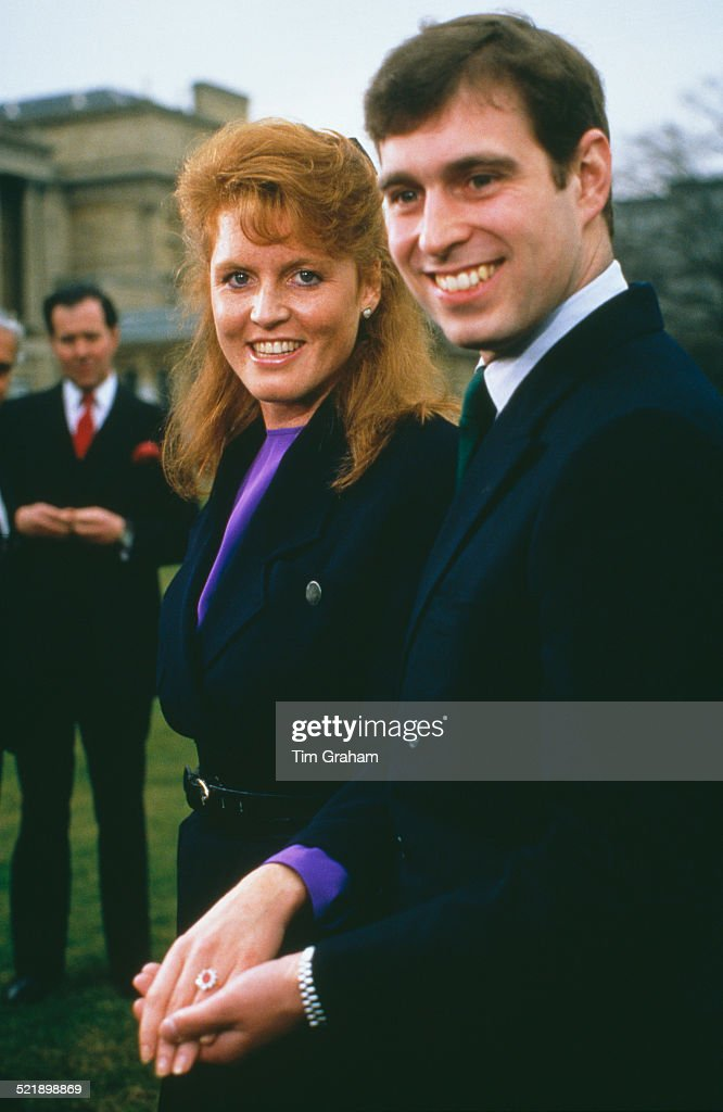 Prince Andrew with <a gi-track='captionPersonalityLinkClicked' href=/galleries/search?phrase=Sarah+Ferguson+-+Hertogin+van+York&family=editorial&specificpeople=160596 ng-click='$event.stopPropagation()'>Sarah Ferguson</a> at Buckingham Palace after the announcement of their engagement, London, 17th March 1986. Ferguson's white and yellow gold engagement ring features a Burma ruby, surrounded by ten drop-diamonds.