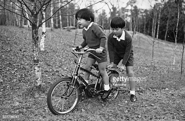 Prince Aya and Prince Hiro the sons of Emperor Akihito and Empress Michiko of Japan playing in the grounds of Togu Palace in Tokyo around the time of...