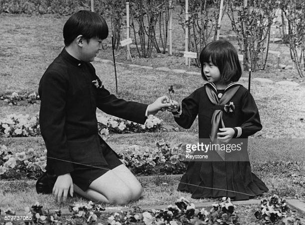Prince Aya and Sayako Princess Nori the youngest children of Emperor Akihito and Empress Michiko of Japan playing in the grounds of Togu Palace in...