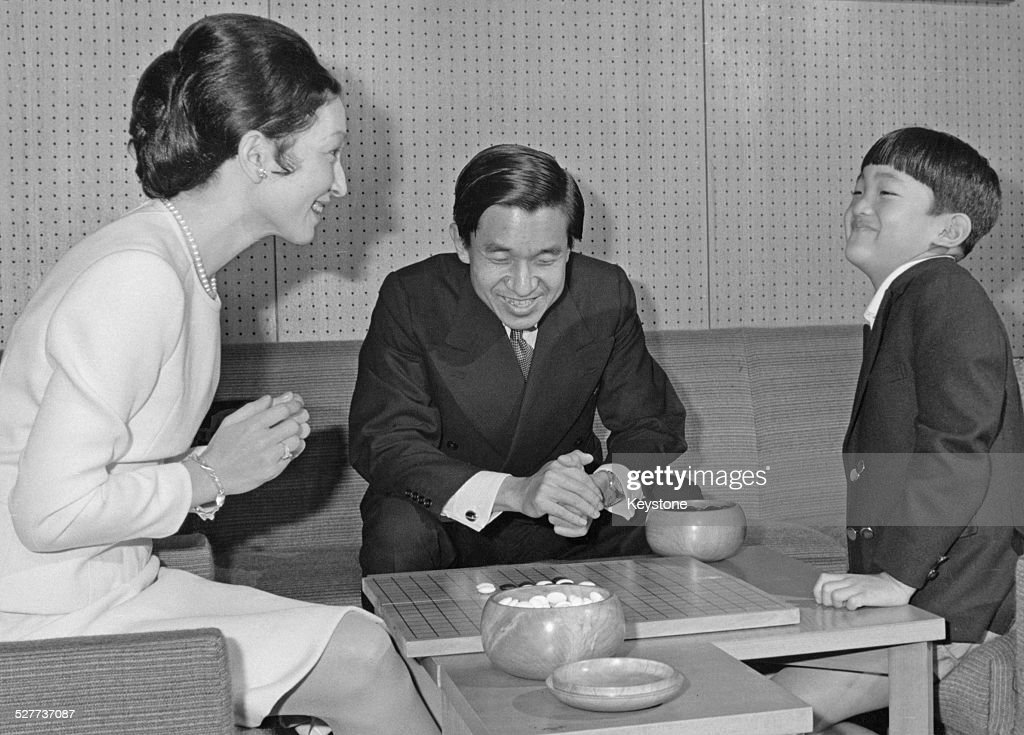 Prince Aya, the second son of Emperor Akihito and Empress Michiko of Japan, playing Go with his parents around the time of his 8th birthday, Japan, November 1973.
