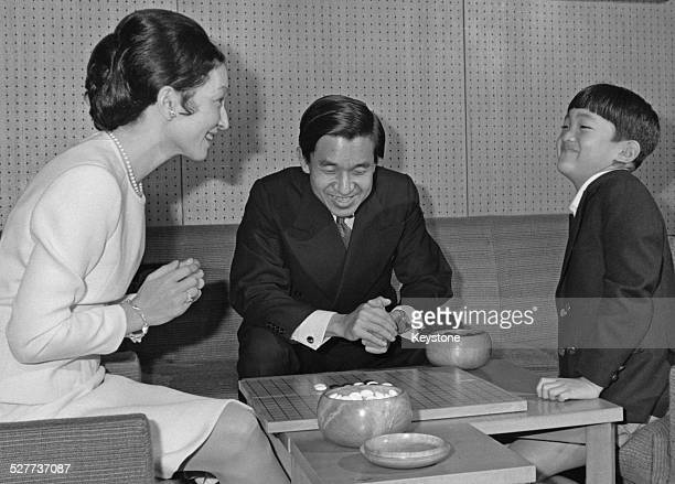 Prince Aya the second son of Emperor Akihito and Empress Michiko of Japan playing Go with his parents around the time of his 8th birthday Japan...