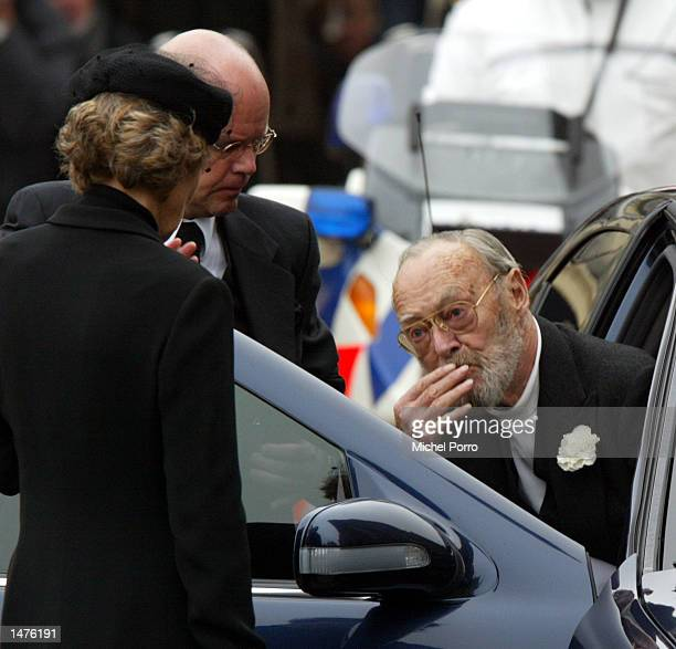 Prince Bernhard father of Dutch Queen Beatrix gives a hand kiss to his daughter Princess Irene after the funeral ceremony of Prince Claus of the...