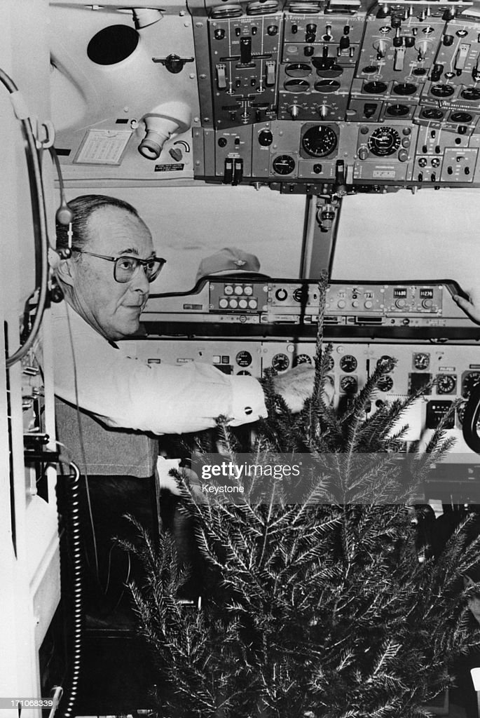 Prince Bernhard of the Netherlands in the cockpit of his private plane with a christmas tree given to him by the people of Goslar after he visited...