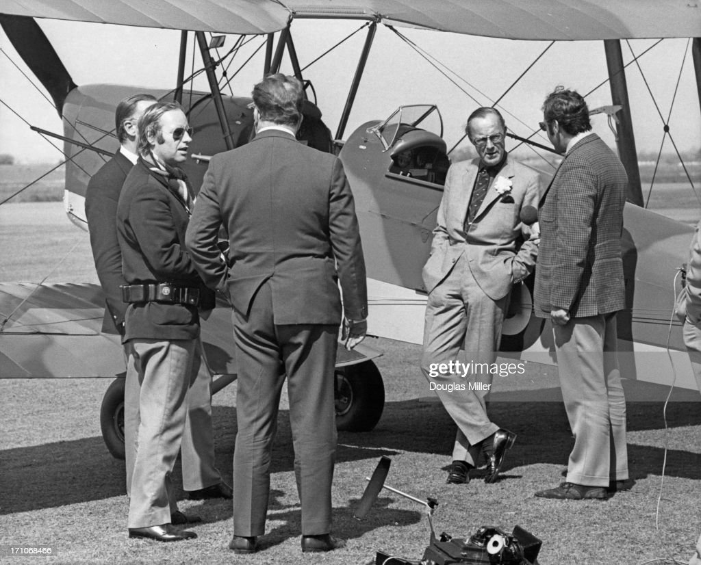 Prince Bernhard of the Netherlands leaning on a Tiger Moth biplane as he talks to Dutch pilot and author Erik Hazelhoff Roelfzema at RAF Upwood...