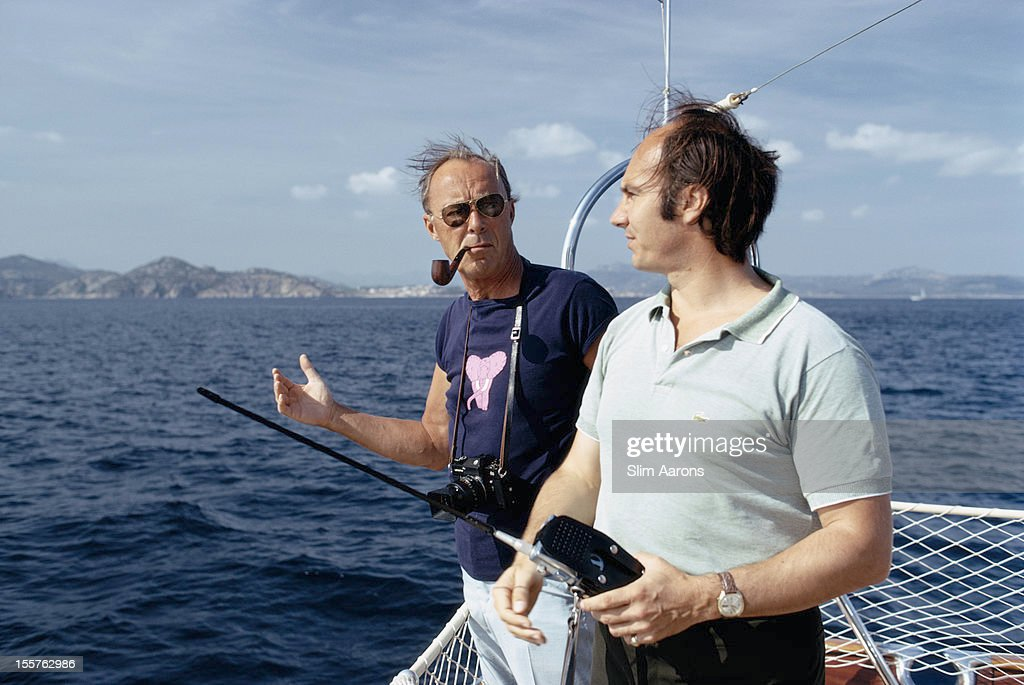 Prince Bernhard of the Netherlands smoking a pipe and Prince Karim Aga Khan IV fishing in the waters off the coast of Porto Cervo on the Costa...