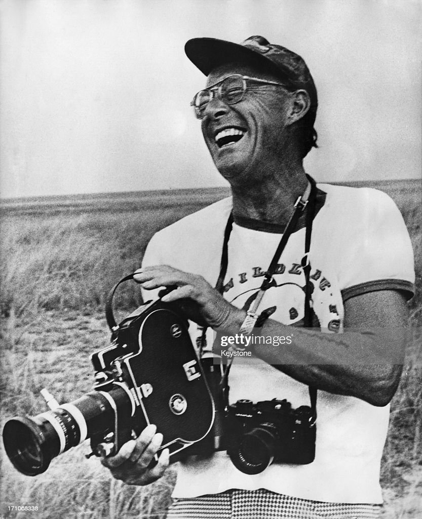 Prince Bernhard of the Netherlands (1911 - 2004) with a movie camera during a visit to Virunga National Park, Zaire (now Democratic Republic of the Congo), 20th August 1973. The prince is wearing a World Wildlife Fund t-shirt.