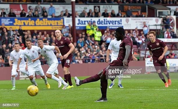 Prince Buaben of Hearts scores from the penalty spot during the UEFA Europa League First Qualifying Round match between Heart of Midlothian FC and FC...