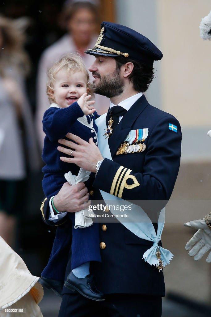 Prince Carl Philip holding Prince Alexander, Duke of Sodermanland leaves the chapel after the christening of Prince Gabriel of Sweden at Drottningholm Palace Chapel on December 1, 2017 in Stockholm, Sweden.
