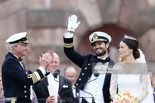 Prince Carl Philip of Sweden and his wife Princess Sofia of Sweden are being congratulated by King Carl XVI Gustaf of Sweden after their marriage...