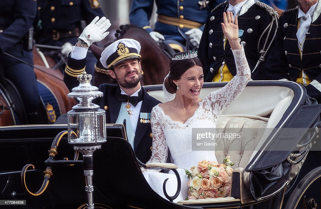 Prince Carl Philip of Sweden and his wife Princess Sofia of Sweden ride in the wedding cortege after their marriage ceremony on June 13, 2015 in Stockholm, Sweden.